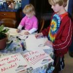 Rosebud & Goldensun make signs for Mom.